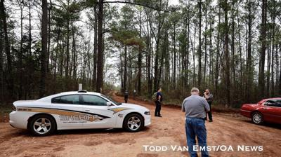 Authorities gather Tuesday near the scene of a fatal plane crash near Dadeville.