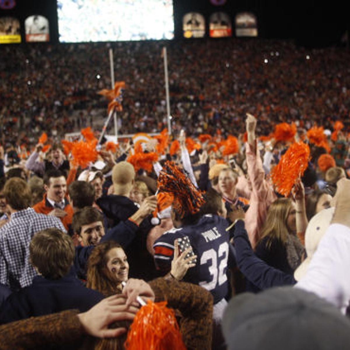 Auburn Football Fans Rush Field In Celebration Of Iron Bowl