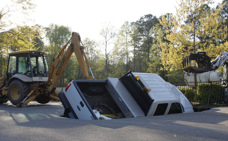 auburn city truck swallowed by sinkhole at hickory dickory park auburn. Black Bedroom Furniture Sets. Home Design Ideas