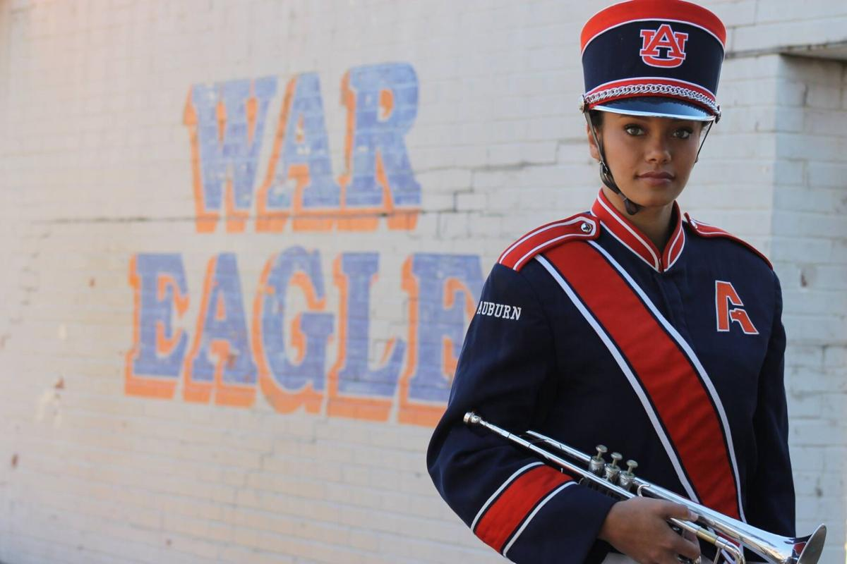 Brianna Jarvis poses in front of 'War Eagle' wall