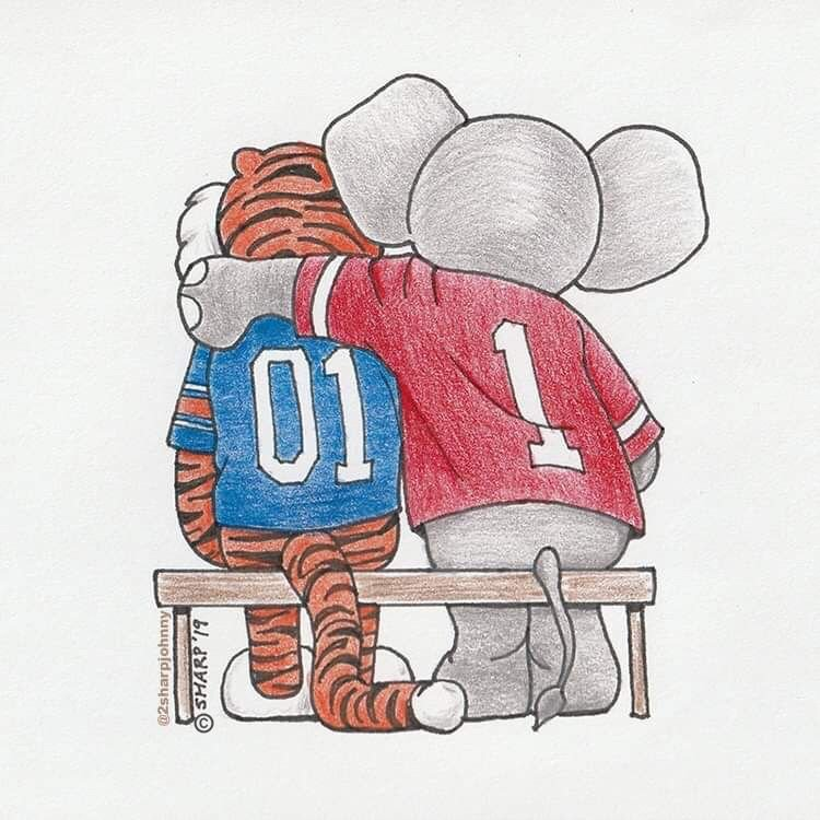 Big Al comforts Aubie with a hug