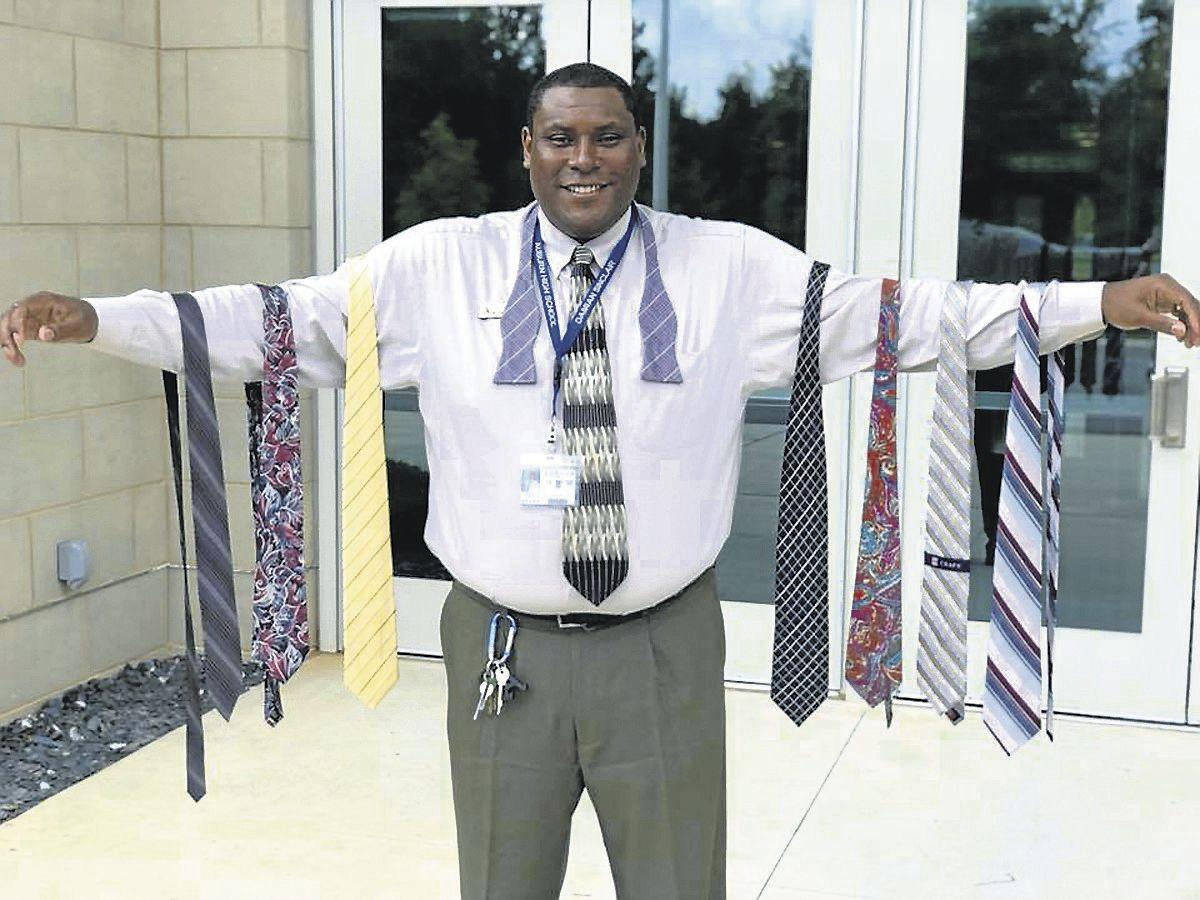 Tie a tie tuesdays offers community connections news oanow auburn high school assistant principal damian sinclair has started an initiative to teach young men how to tie a neck tie daniel chesser auburn city ccuart Gallery