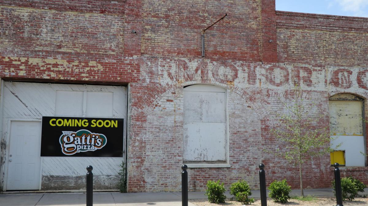 A Mr. Gatti's Pizza 'Coming Soon' sign appears on 1st Avenue building