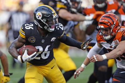 Bell carries Steelers to win over Bengals