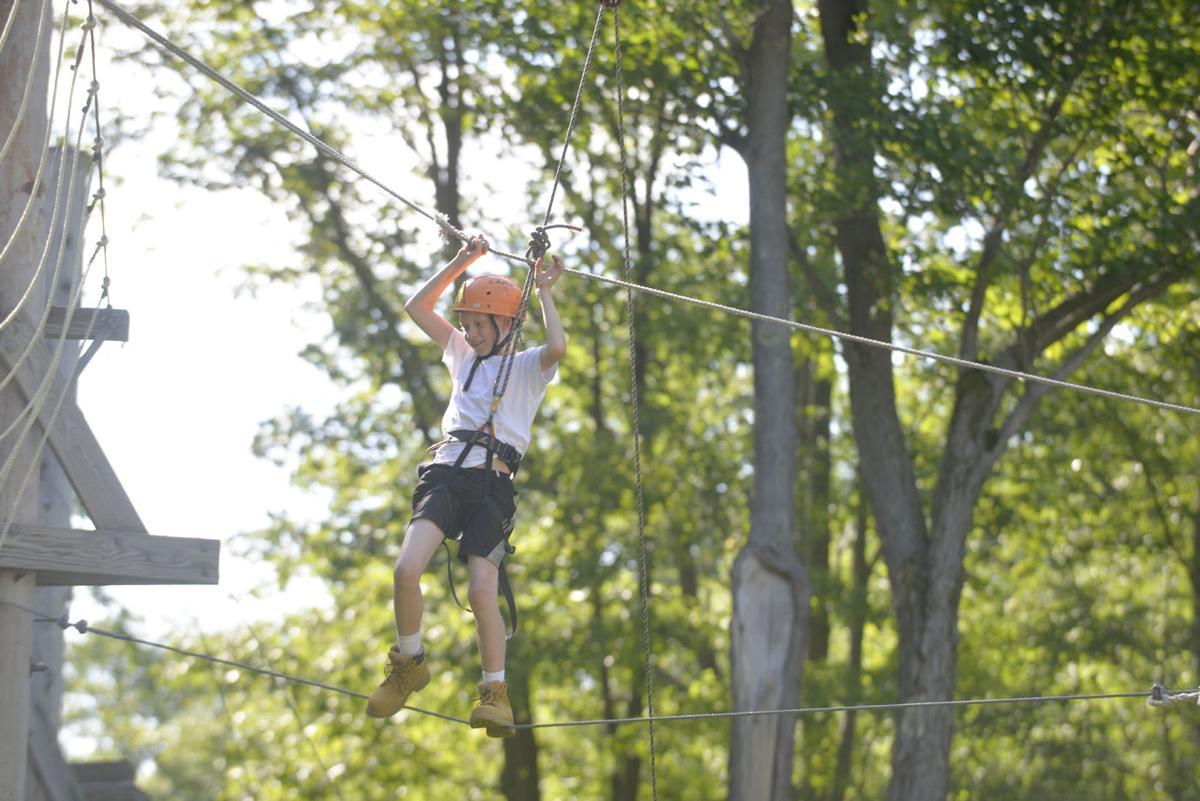 Cadet Harding crosses the high ropes