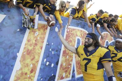 WVU QB Grier the 3rd most popular brother in his family
