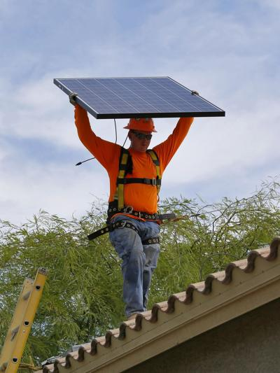 Big utilities enter market for small rooftop solar jobs