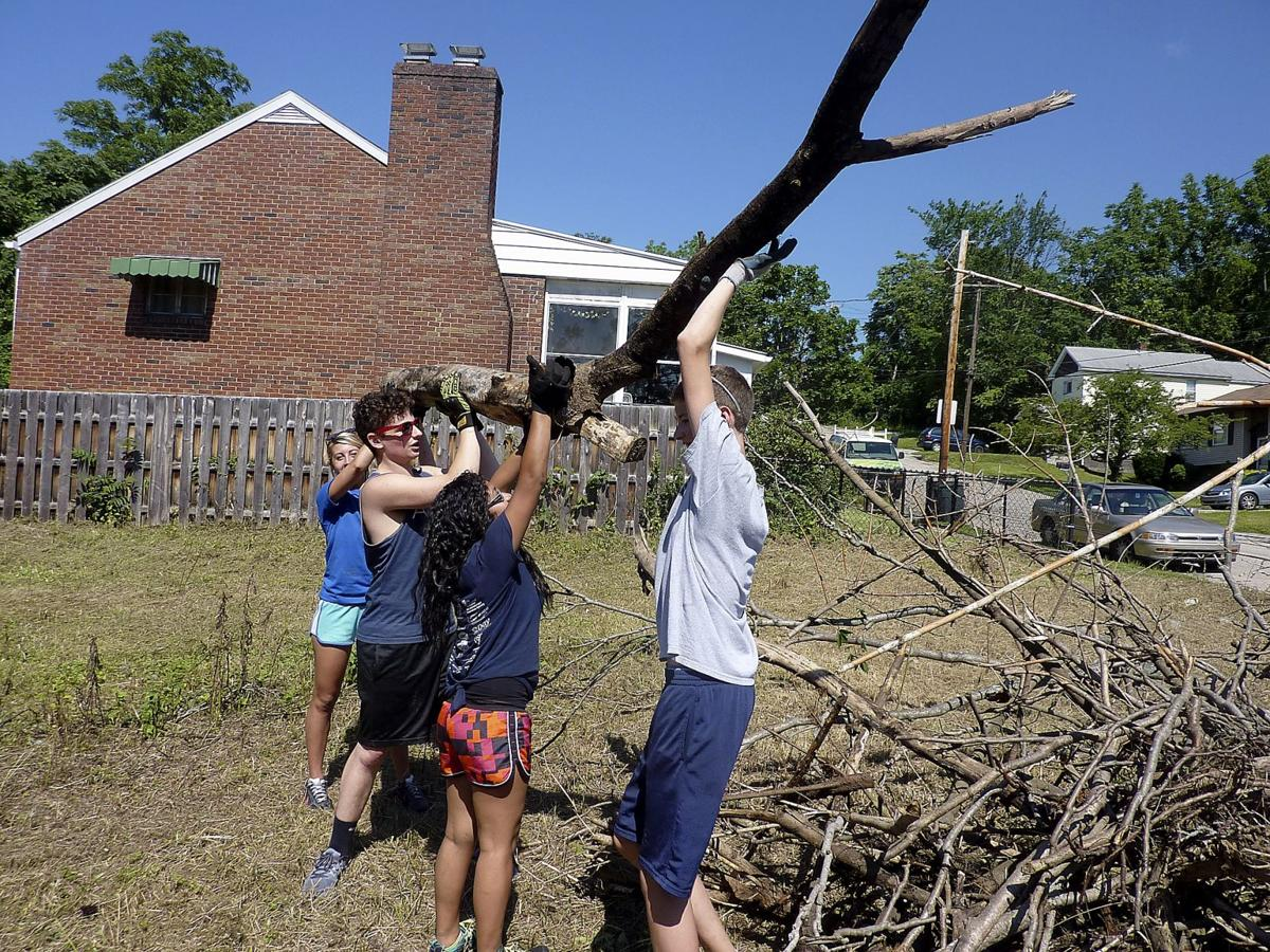 Highland Ridge CDC, churches and kids mend fences, more in the community