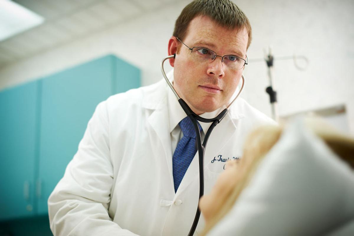 Dr. J. Travis Wilson