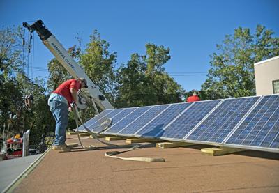 Solar panels shining on Wash High stadium