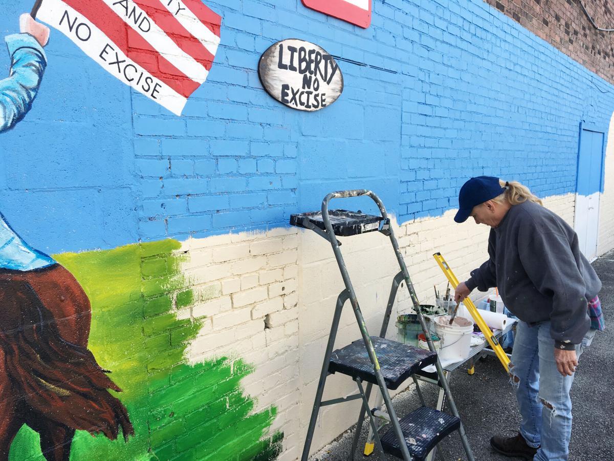 20201018_loc_mural_artist_in_action.JPG