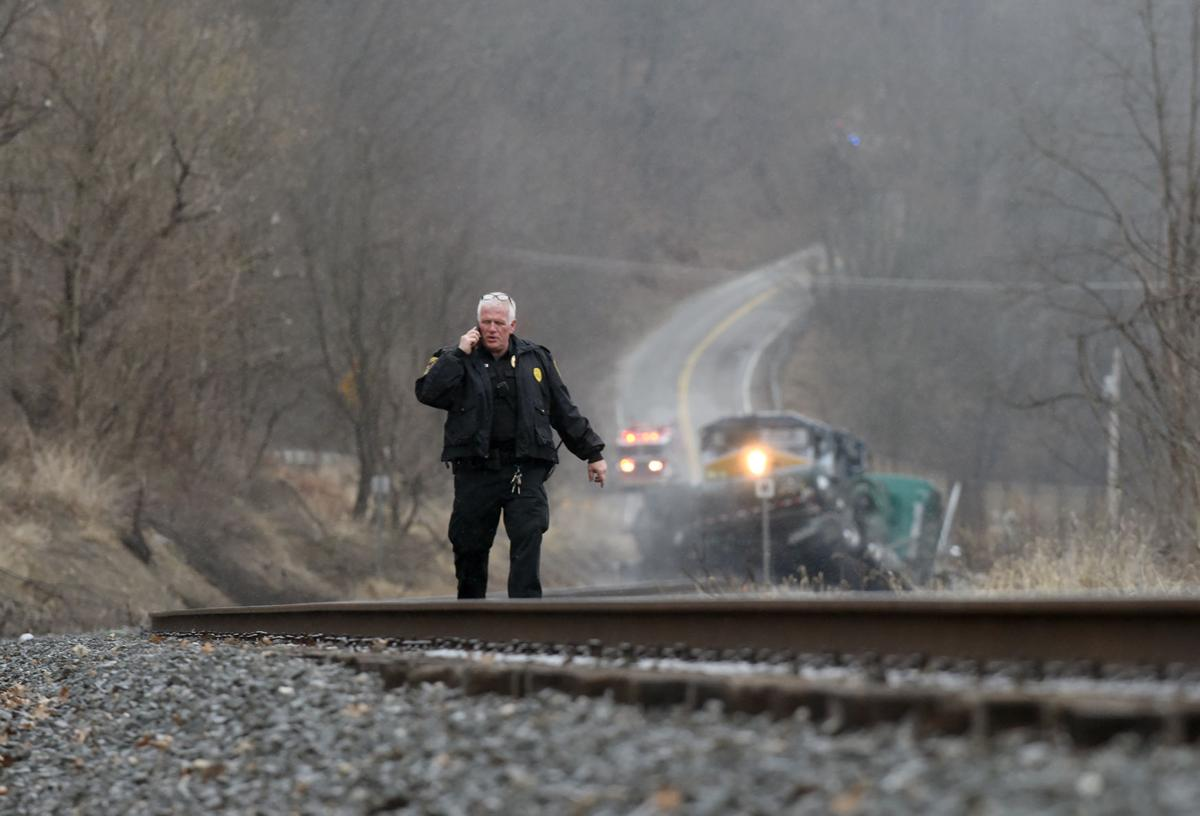 Train hits tanker truck carrying 4,400 gallons of hydrochloric acid solution near Fredericktown