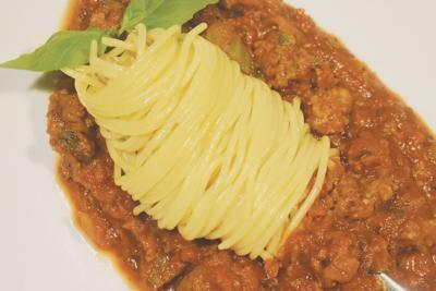 Veggie and meat sauce over thin spaghetti