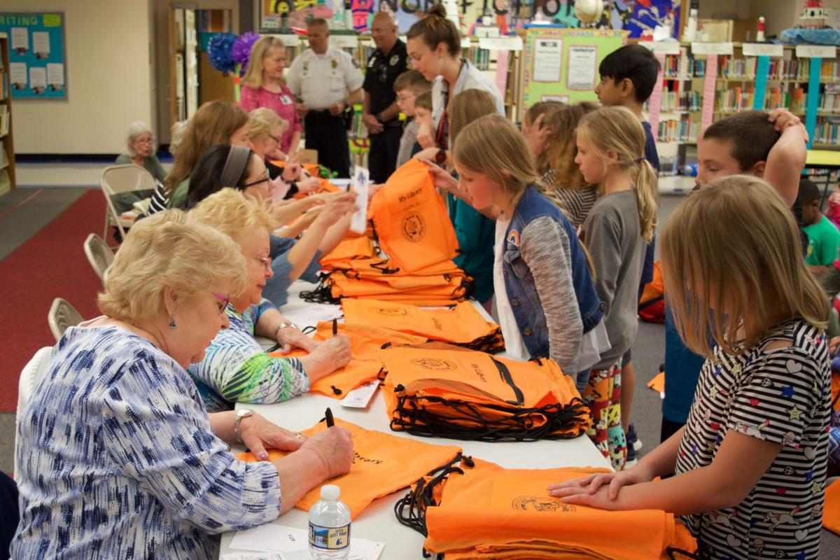 Wor. Co. students given backpacks filled with books