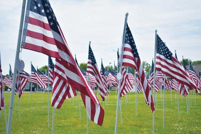 Flag display shifts focus to include essential workers