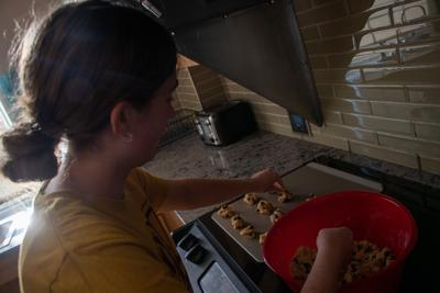 Molly making cookies