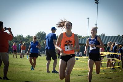 Grace Baker crossing the finish line