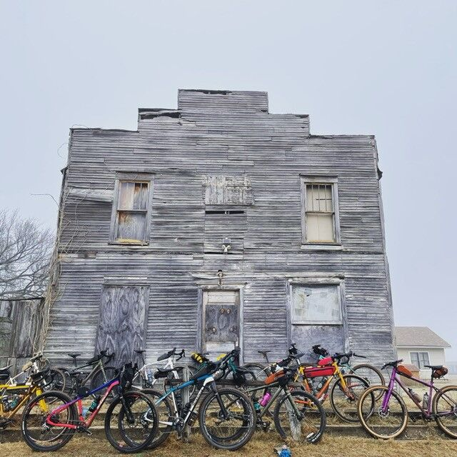 Bicycles leaned against building