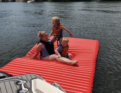 Kristine Rohwer with kids at the lake
