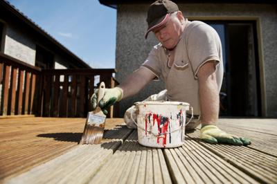 Man painting decking