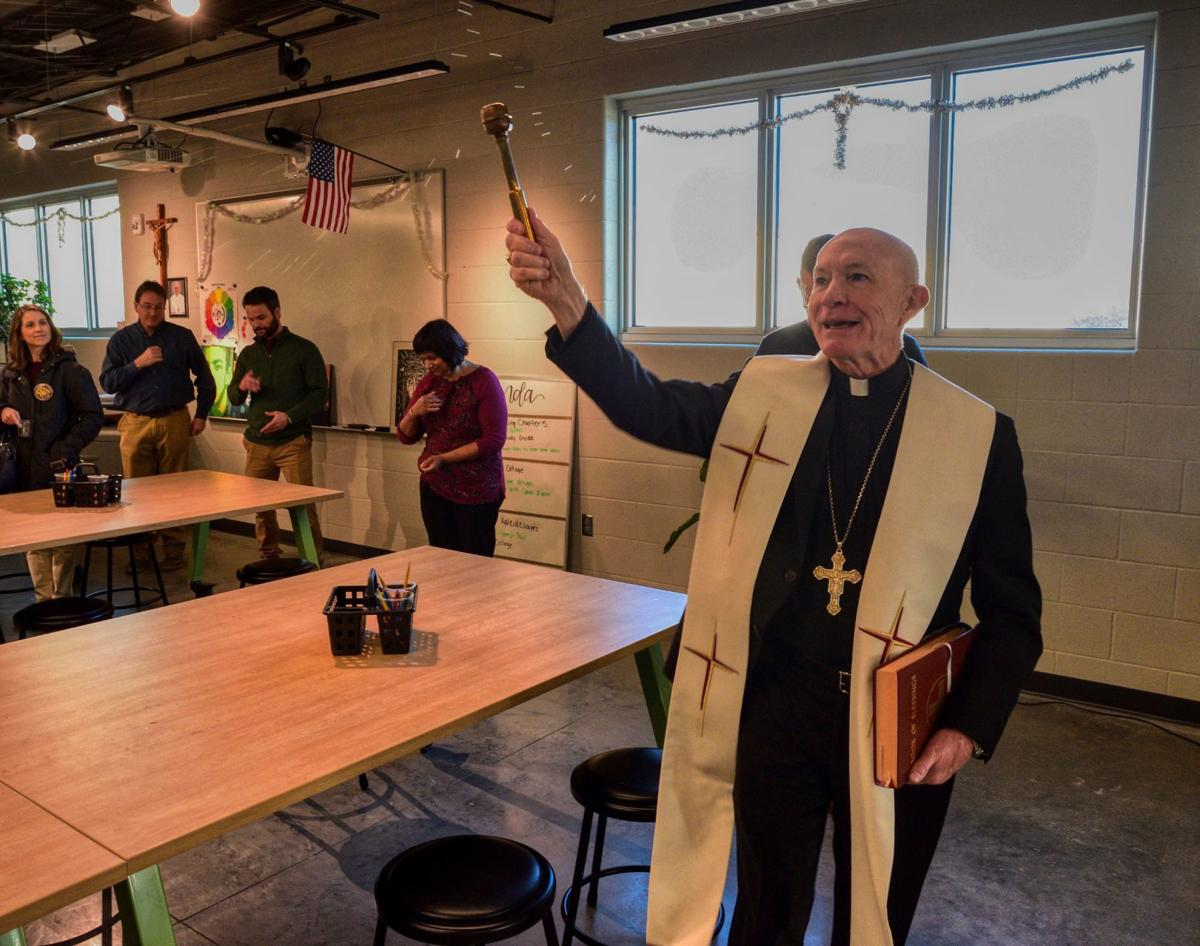 Archbishop George Lucas blesses an art classroom at Skutt Catholic High School Thursday