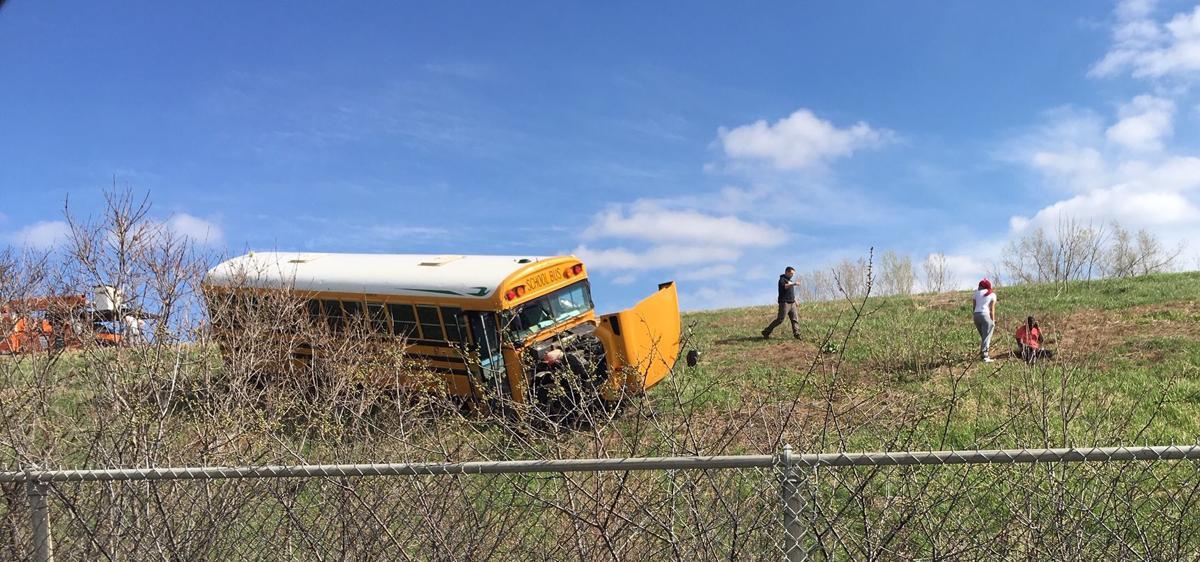 School bus goes off Interstate after crash