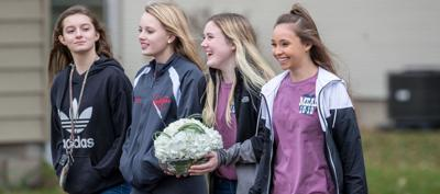 Mead High FFA students create smiles with repurposed flowers