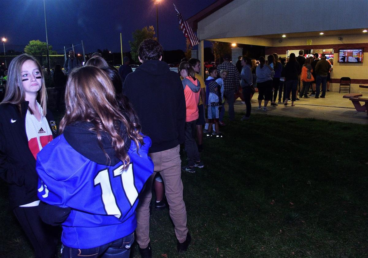 The Roncalli Catholic High School concession stand attracts a crowd