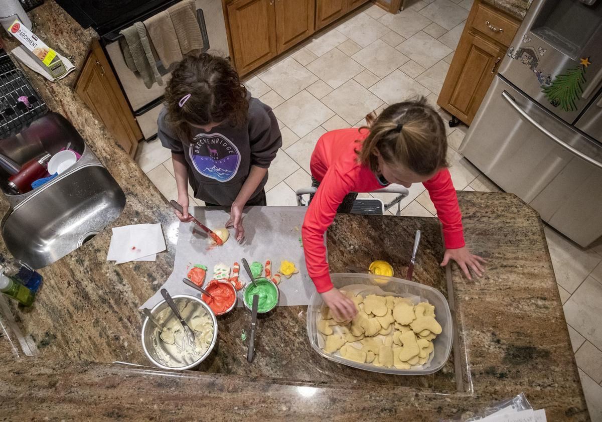 Leick sisters frosting cookies