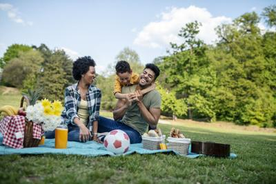 Happy family spending a spring day on picnic