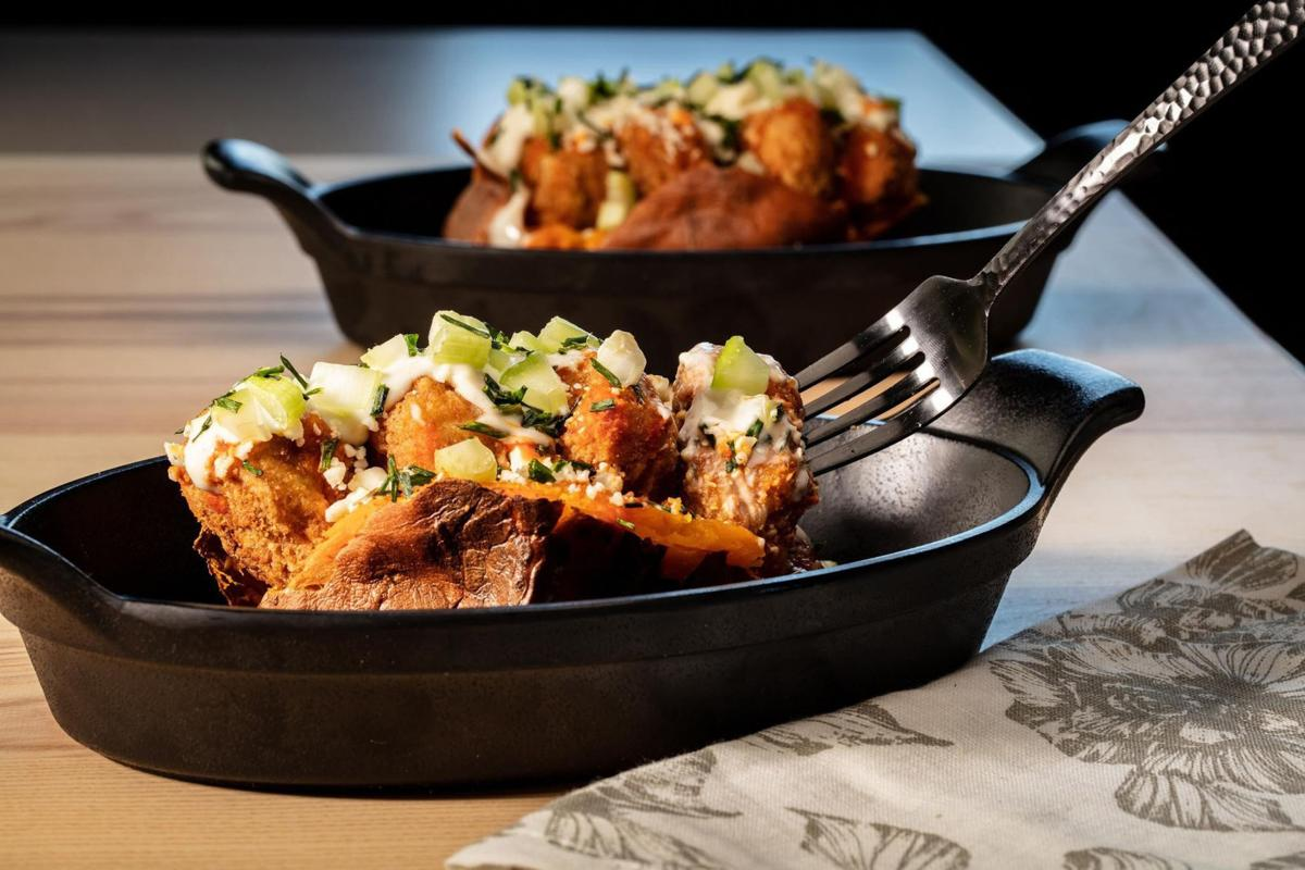 The classic idea of a loaded baked potato becomes dinner all by itself. Here sweet potatoes take the place of russets, and Buffalo chicken wings inspire the toppings. Think crispy chicken nuggets, blue cheese and hot sauce.