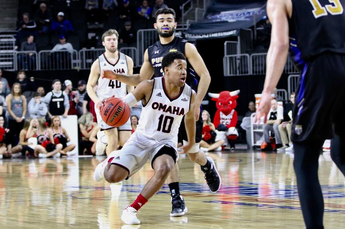 Ayo Akinwole drives toward the basket in the Summit League semifinals.