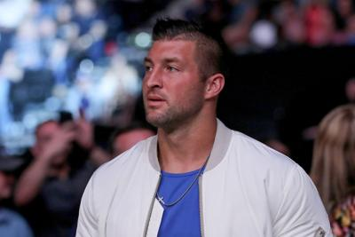 Tim Tebow is seen by the octagon during UFC 261 at VyStar Veterans Memorial Arena on April 24, 2021 in Jacksonville, Florida.
