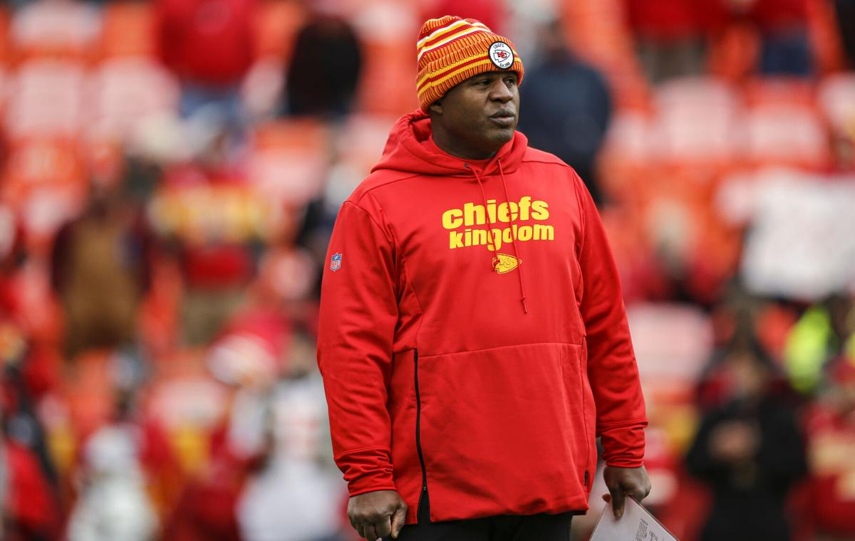 Kansas City Chiefs offensive coordinator Eric Bieniemy watches pregame warmups prior to the game against the Los Angeles Chargers at Arrowhead Stadium on December 29, 2019, in Kansas City, Missouri.