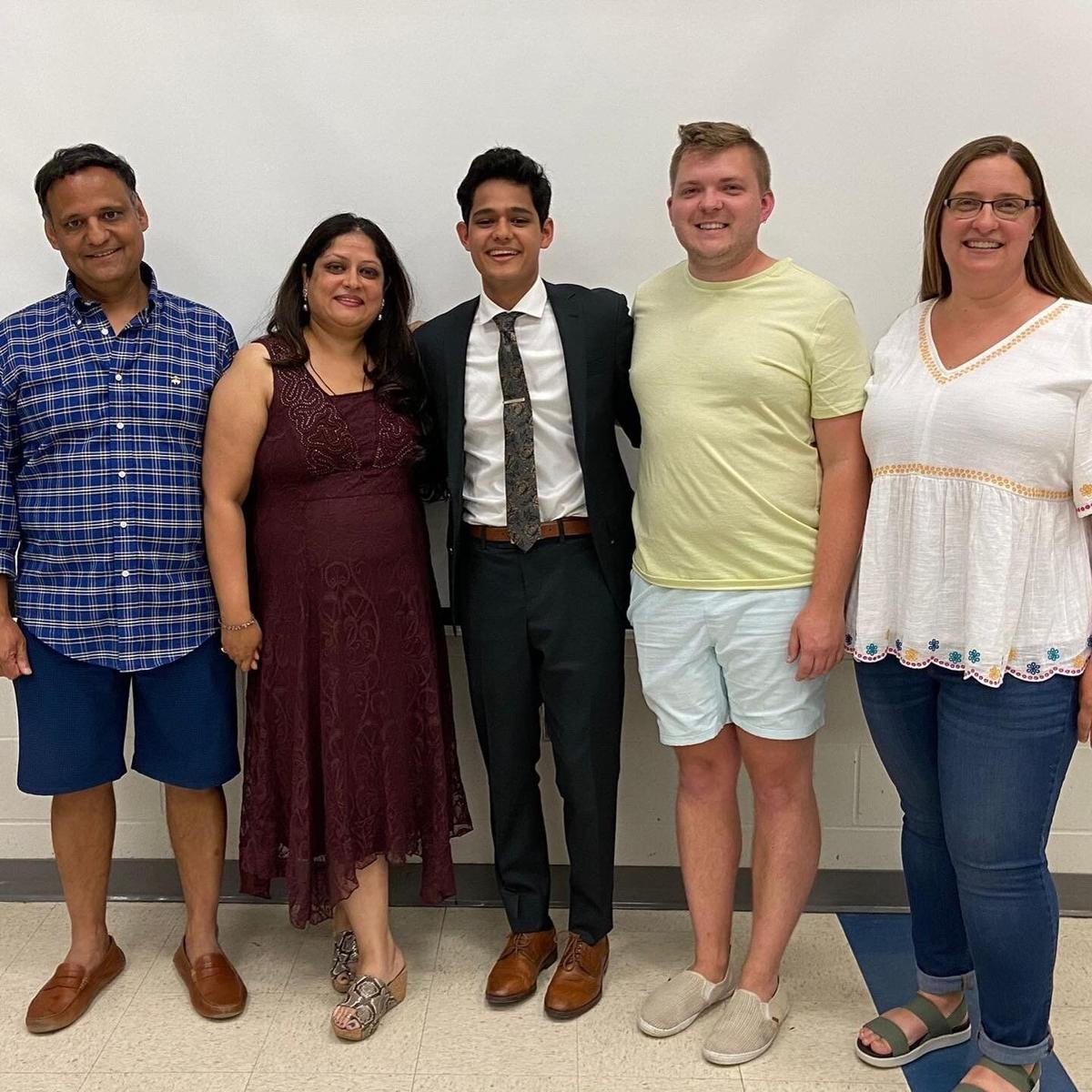 Pranay Mathur with parents and coaches
