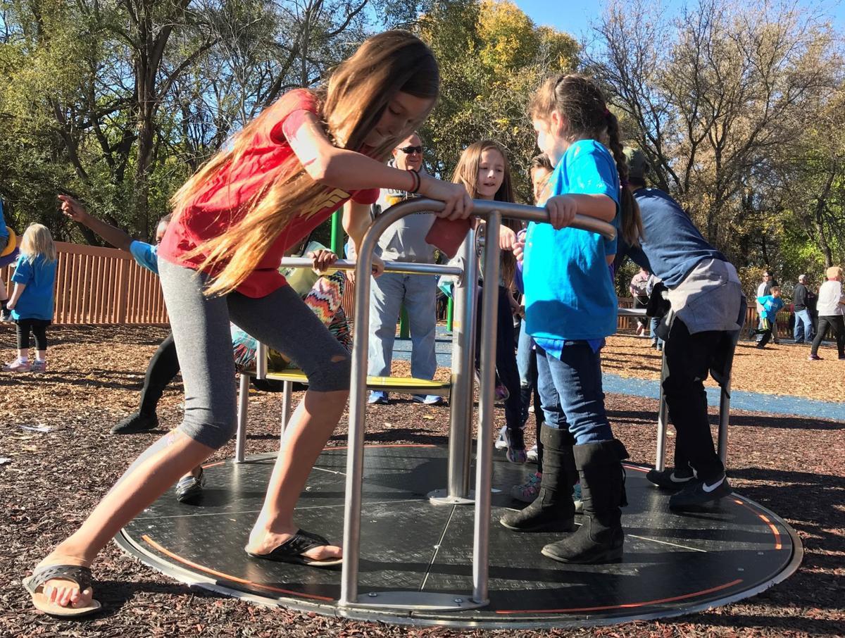 Handicap accessible merry-go-round a hit