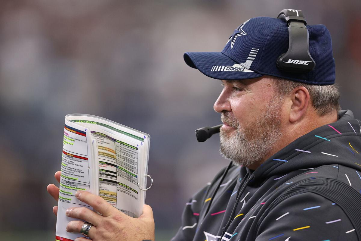 Head coach Mike McCarthy of the Dallas Cowboys looks on during the second half against the Carolina Panthers at AT&T Stadium on October 03, 2021 in Arlington, Texas.