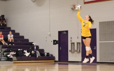 Omaha Burke freshman Erin Carlson isn't afraid to stand tall against bigger players at the net
