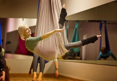 Omaha aerial yoga classes combine hammocks, acrobatics