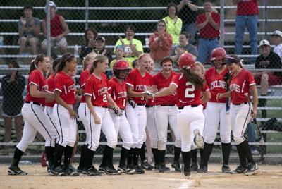 Schaben family, oldest to youngest, celebrating Harlan's softball turnaround