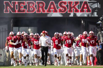 Scott Frost and players
