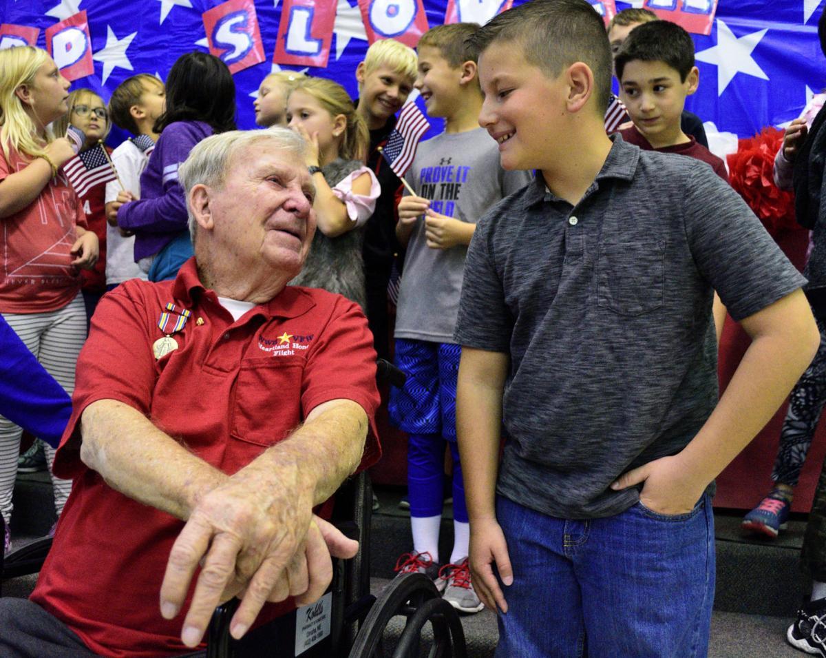 Pen pals Richard Slovek, a World War II veteran, and Charlie Fish, a fourth grade student