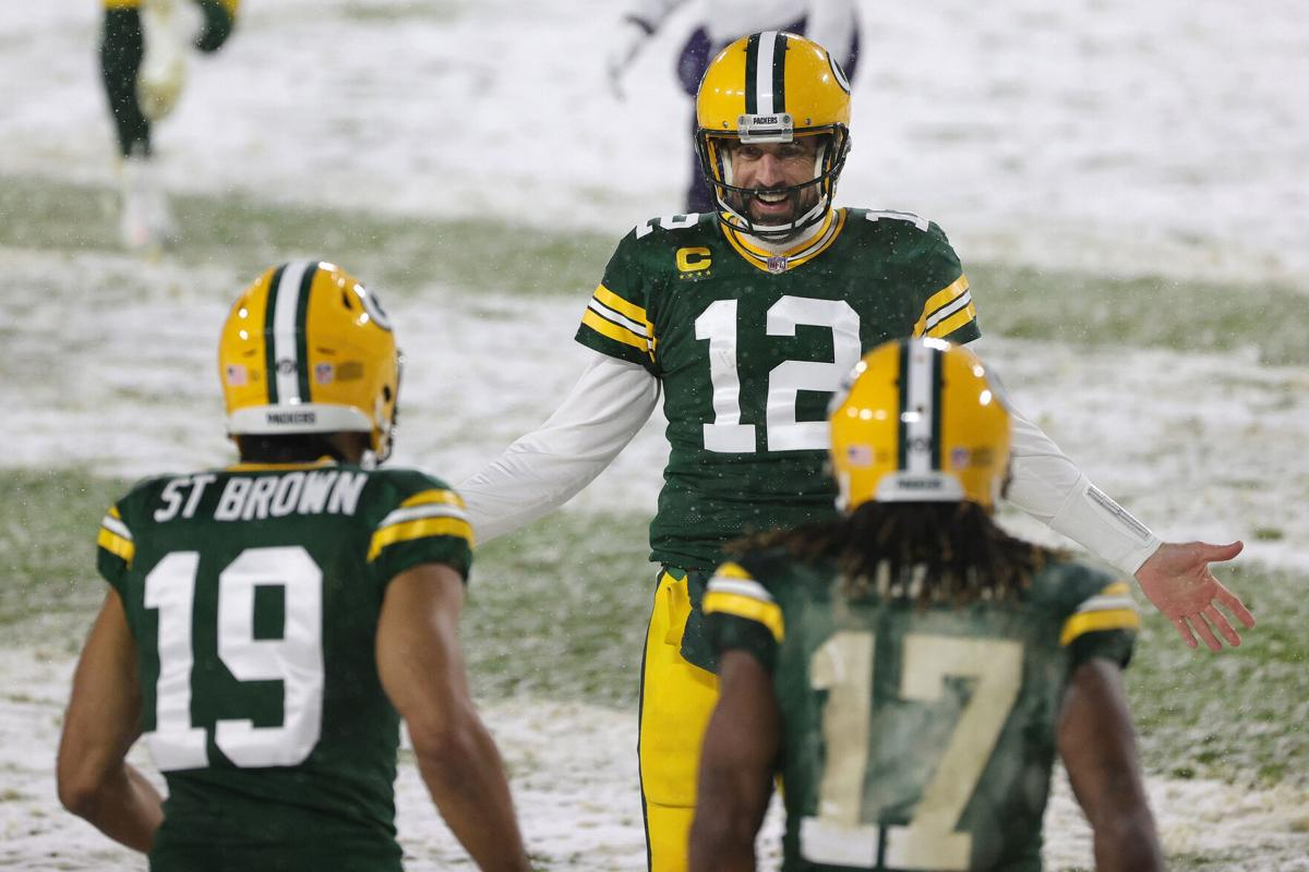 Quarterback Aaron Rodgers #12 of the Green Bay Packers celebrates a touchdown pass to Equanimeous St. Brown #19 against the Tennessee Titans during the second quarter at Lambeau Field on Dec. 27, 2020 in Green Bay, Wisconsin.