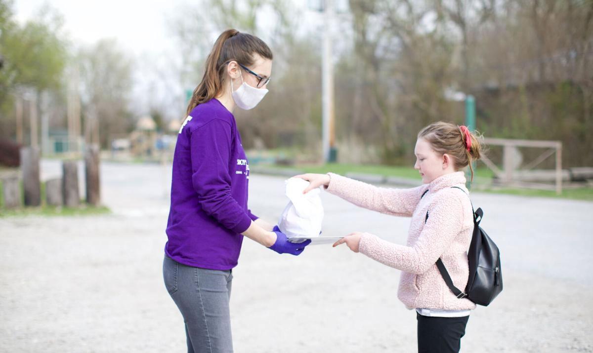 Carter Lake Club staff handing out meals to a Club member.jpg