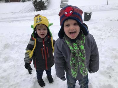Sam and Elliott Coffey in the snow