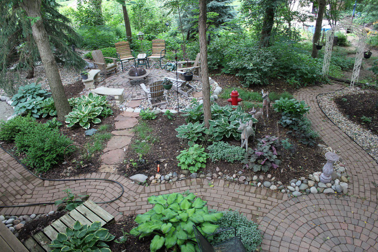 Dig, Plant, Relax: Over 2 Decades, Papillion Man Turns Backyard Into  Gardening Sanctuary
