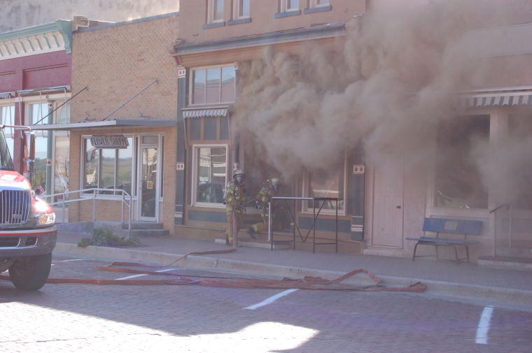 Fast-spreading fire damages flower shop, roof of bar in downtown Woodbine, Iowa
