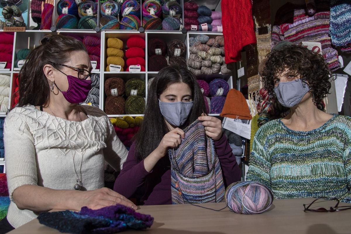 Ellen Rubin, left, Isabel Cohen, center, with her mother, Karen Lecks, knit at the Luv2Knit& More in Jenkintown.