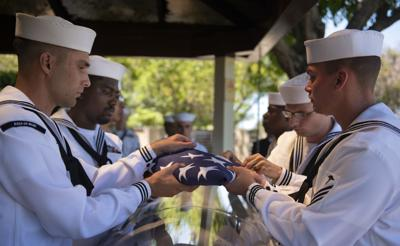 Hawaii sailors folding flag at Grant Cook services (copy)