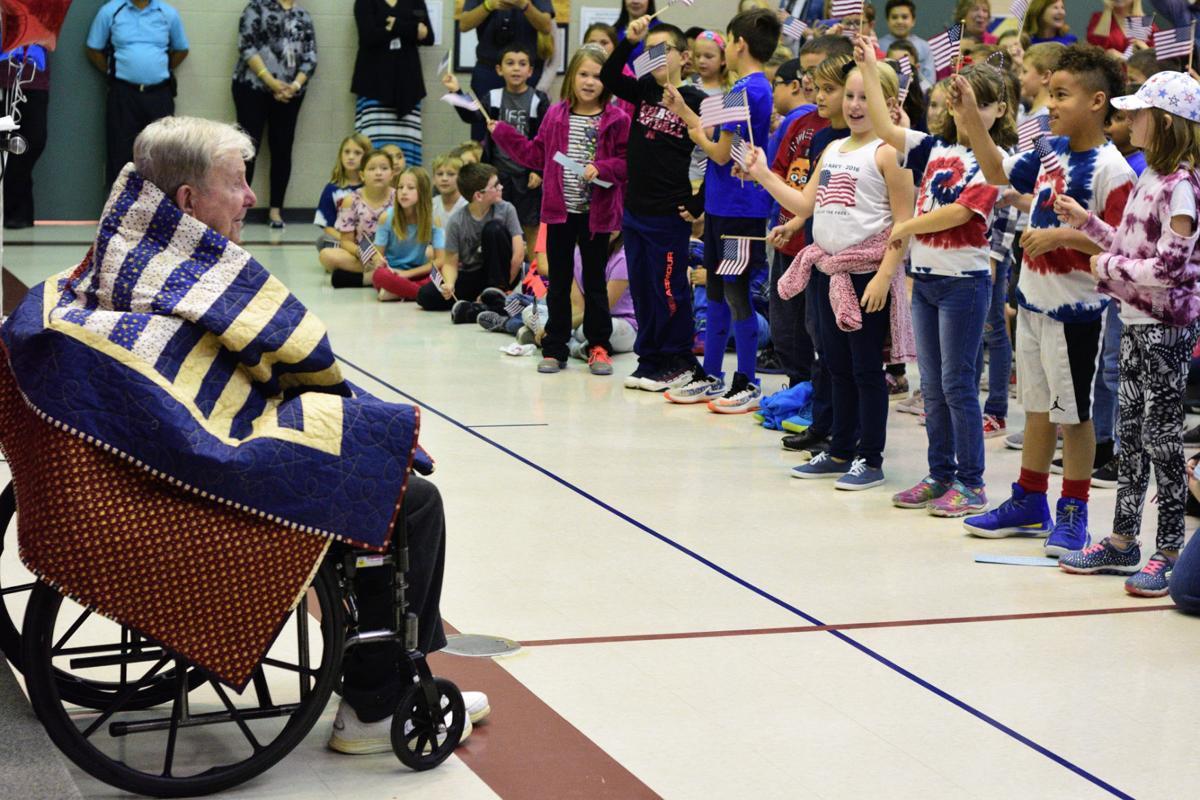 Students sing for World War II veteran Richard Slovek